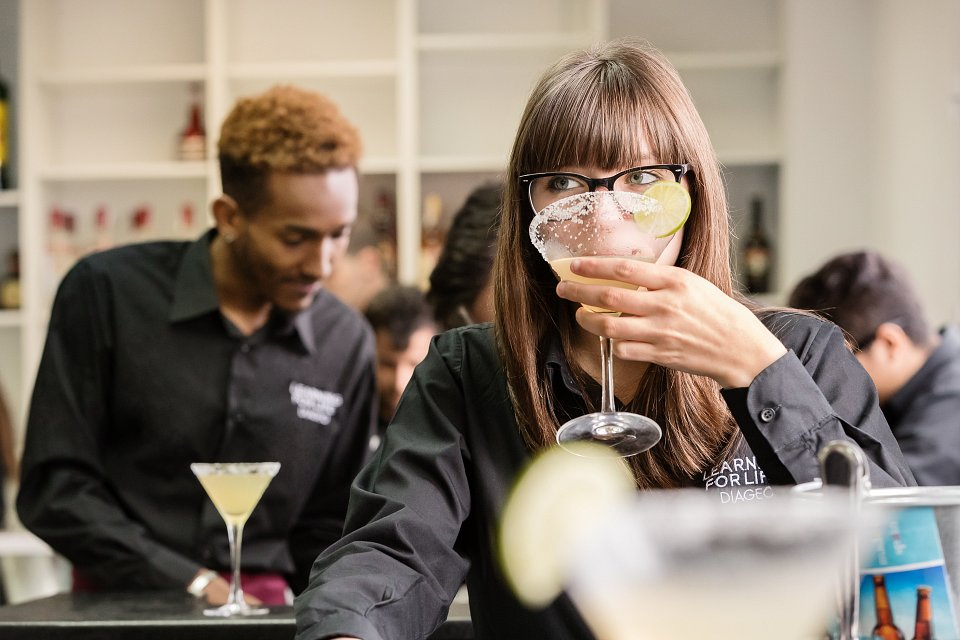 Igor Emmerich, Diageo Europe, lesson learning, woman tasting a drink she has made in a classroom