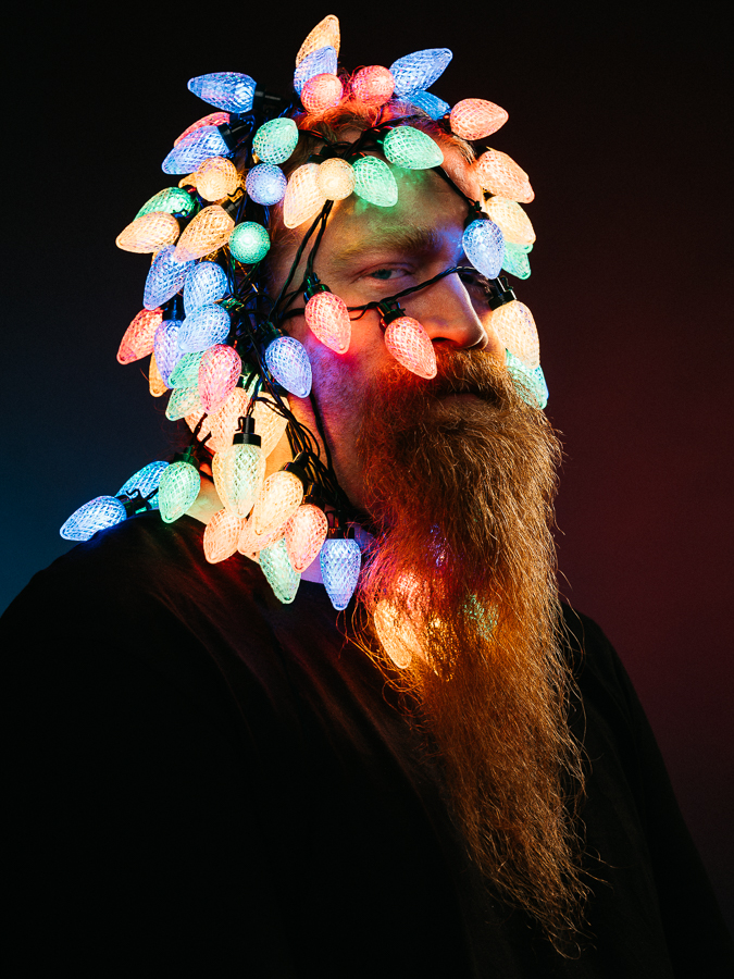 Igor Emmerich, portrait, Christmas, colour, studio, man with red beard, christmas lights, kent, england,