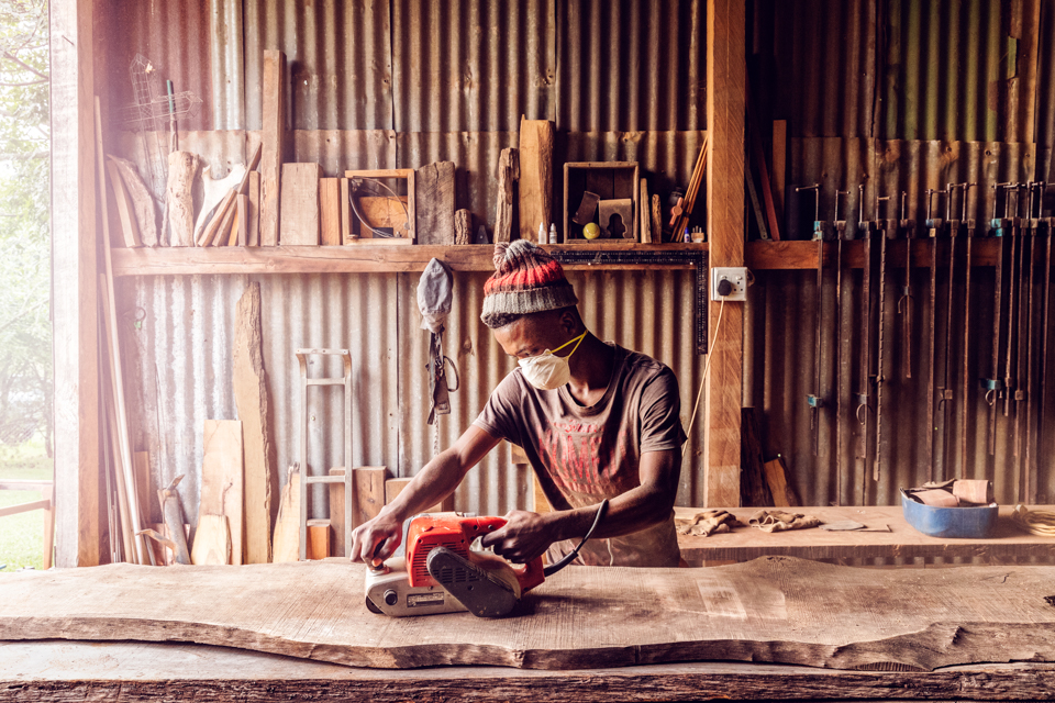 Igor Emmerich, South Africa, workshop, sanding, black, man, African carpenter, craft, wood, warm, sunny