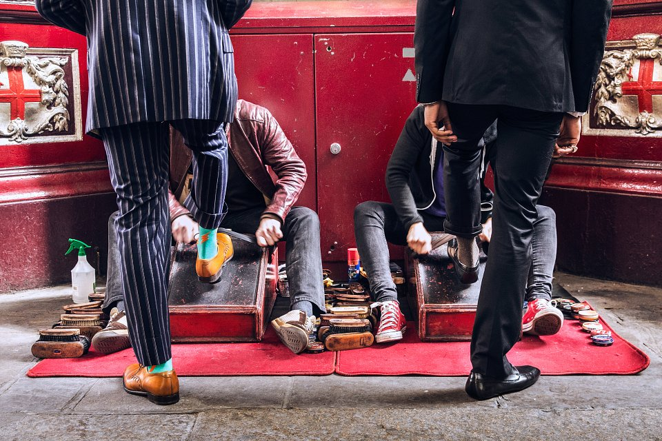 Igor Emmerich, Tangible. Individuality. two business men have their shoes shined