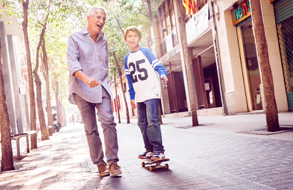 Igor Emmerich, Barcelona. boy goes skateboarding with his grandfather in the streets of barcelona.