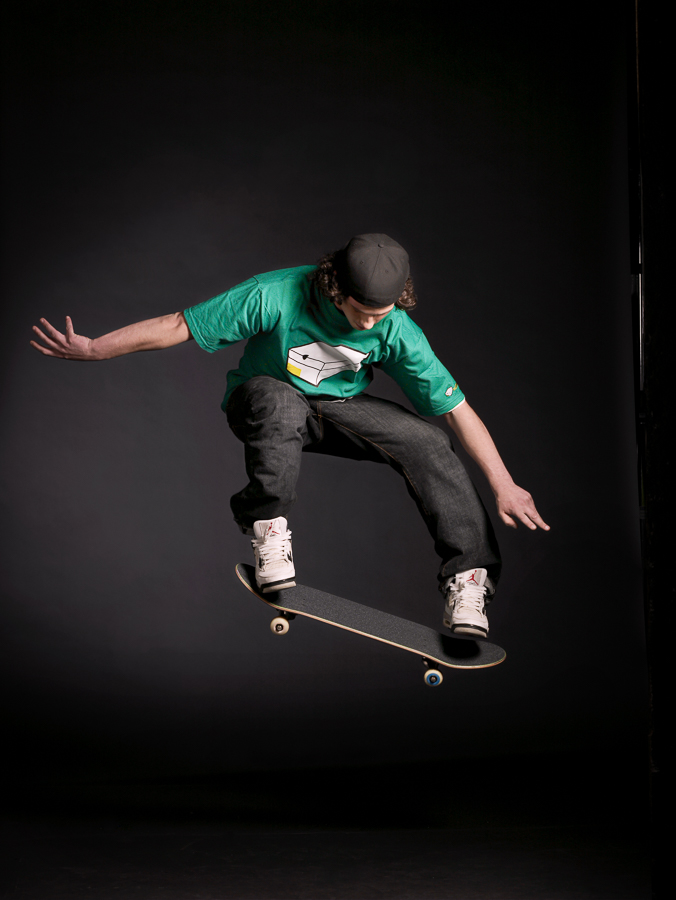 Igor Emmerich, advertising photographer, photographer, portrait photographer, uk photographer, London photographer, kent photographer, england, Young man on a skateboard jumping in mid air shot in a studio against a dar background
