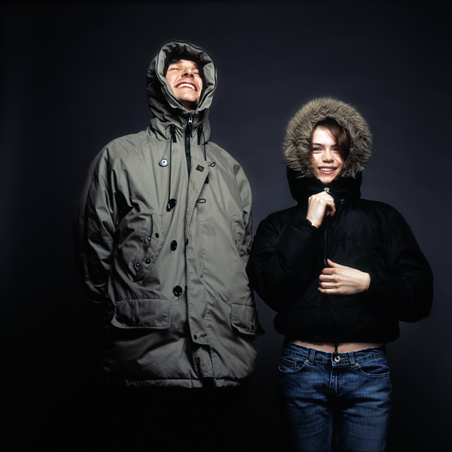 Igor Emmerich, advertising photographer, photographer, portrait photographer, uk photographer, London photographer, kent photographer, england, Portrait of a couple against a dark background wearing hoodies in a studio