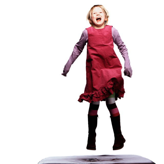Igor Emmerich, advertising photographer, photographer, portrait photographer, uk photographer, London photographer, kent photographer, england, Portrait of a girl jumping up in the air and laughing shot in a  studio against a while background