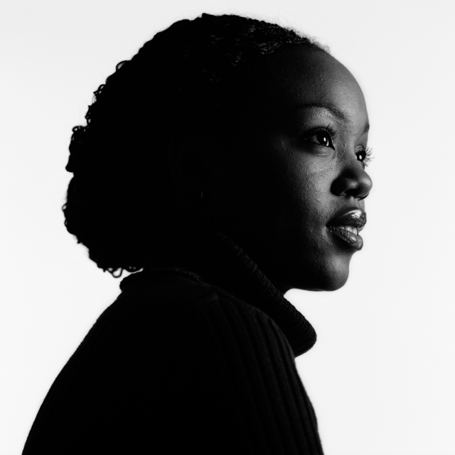 Igor Emmerich, advertising photographer, photographer, portrait photographer, uk photographer, London photographer, kent photographer, england, Portrait of an African woman against a white background looking happy and shot in Black and white