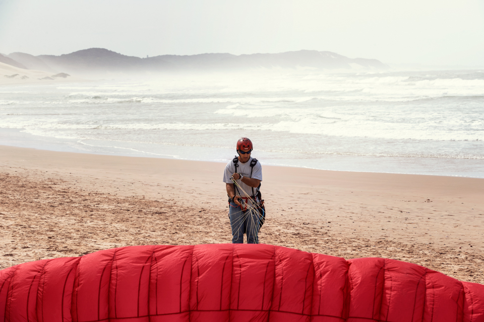 African, Beach, extreme sport, Igor Emmerich, landscape, landscape photographer, lifestyle photographer, Nahoon beach, paraglading, South Africa, sport, sunrise, warm, white man, windy, red