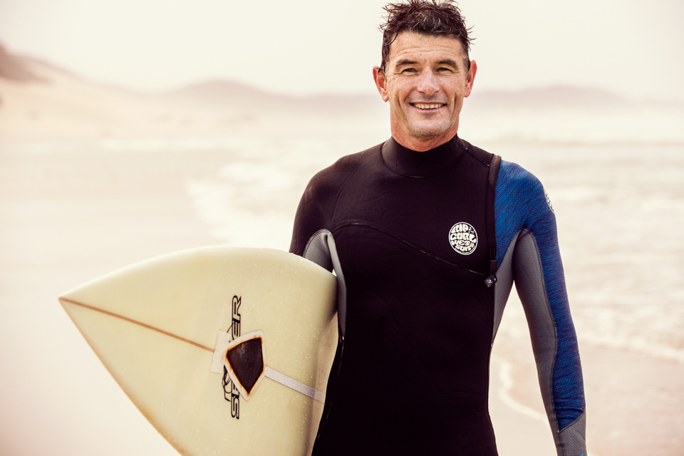 advertising photographer, confident, fgritty, happy, Igor Emmerich, laughing, mature adult, middle age, Nahoon beach, portrait, portrait photographer, South Africa, south african, surfer, warm, white man