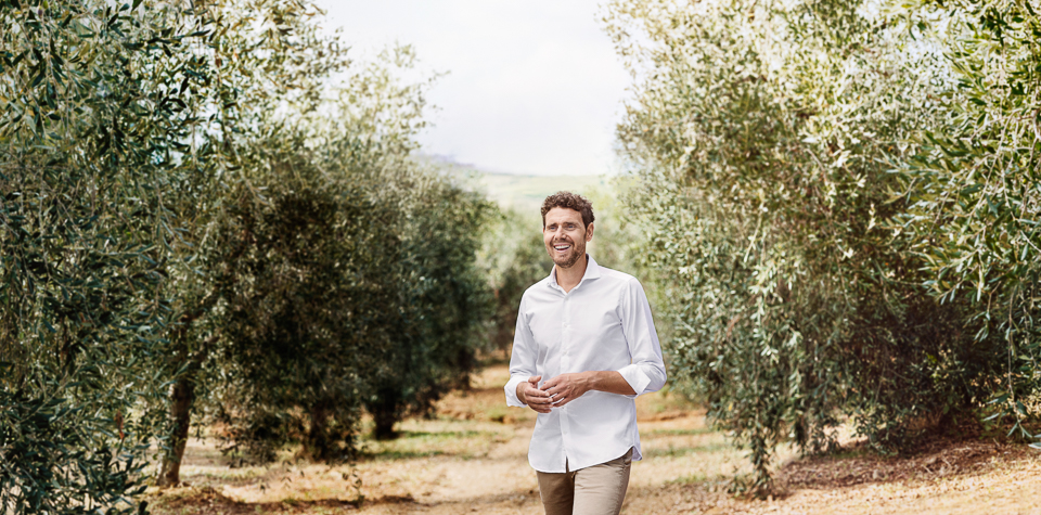Igor Emmerich, advertising photographer, portrait photographer, tuscany, man, hot, warm, sunny, olive grove, happy