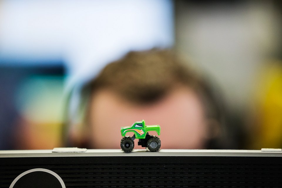 Igor Emmerich, RSA, MSL Group, office, corporate, photography, observations. toy car on computer screen with man's head in background
