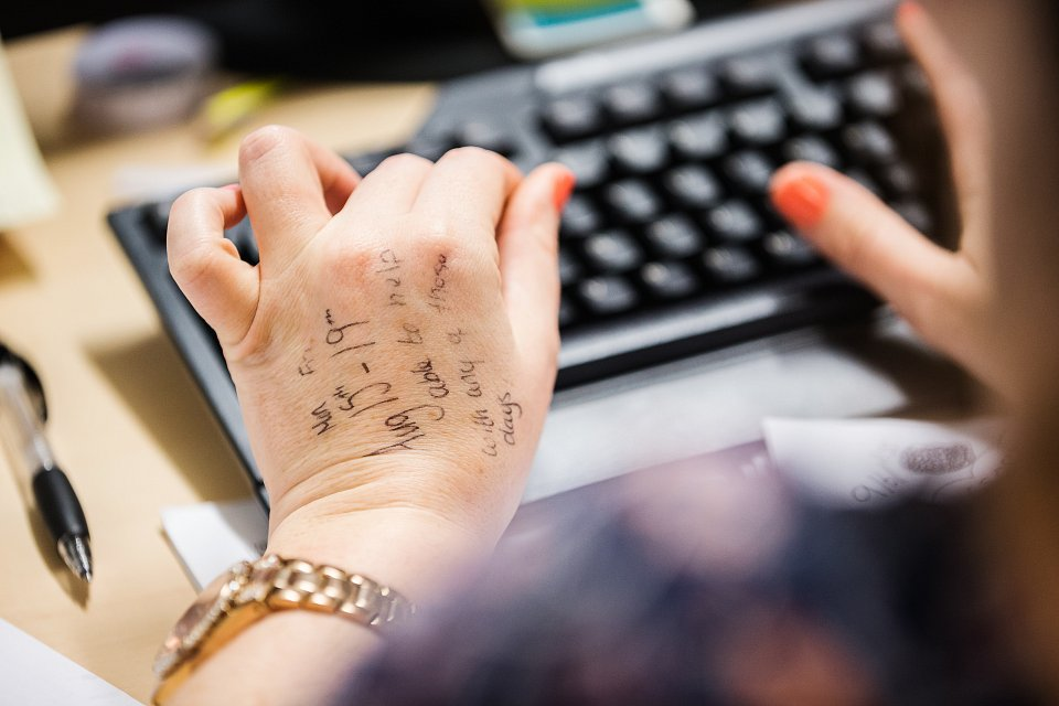 Igor Emmerich, RSA, MSL Group, office, corporate, photography, observations. woman typing with writing on her hand